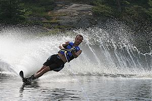 Slalom water skier on lake in southern Ontario