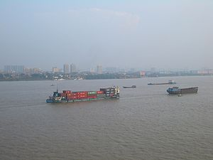 English: Cargo boats on the Changjiang (Yangtz...