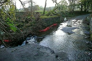 English: Broken bridge over Nant Cwmyrysbryd O...