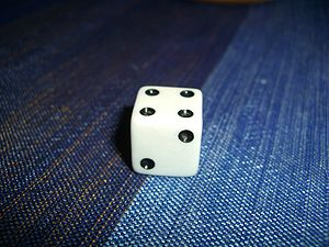 A dice with number 4 upside.