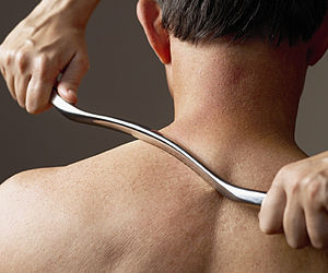 English: Shoulder being treated with the Grast...
