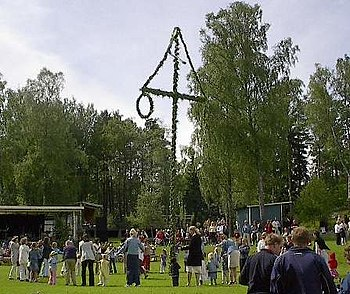 English: Dance around the maypole during the M...