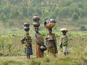 Batwa women with traditional pots. Taken in Bu...
