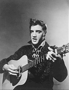 Publicity photo of Elvis playing guitar