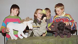 German children performing a tale with selfmad...
