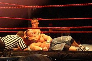 Randy Orton choking John Cena