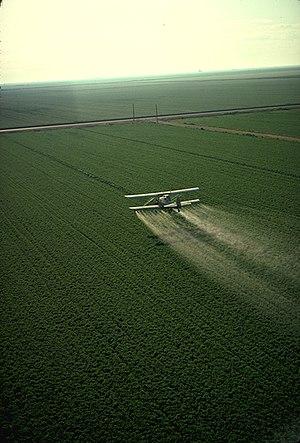 Spraying pesticide in California