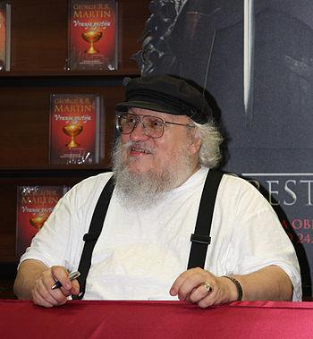 English: George R.R. Martin signing books in a...