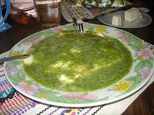 Quesillo cheese in green tomato sauce - Oaxaca...