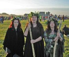 Three female druids on the morning of the summ...