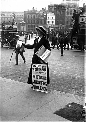 English: British suffragette with a poster, gi...