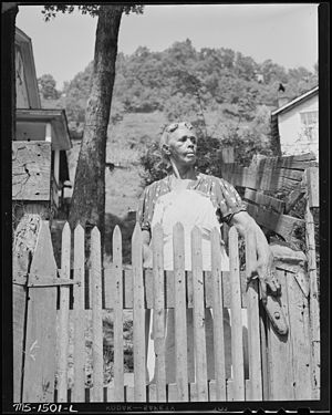 Widow of miner. She lives on state old age pen...