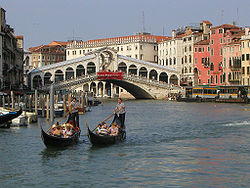 Gondolas in Venice Rialto Bridge in background