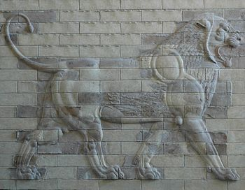 Lion on a decorative panel made of molded bric...