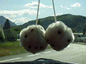Fuzzy dice on a car window