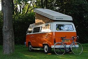 Orange-White Volkswagen T2 Camper Van with ope...