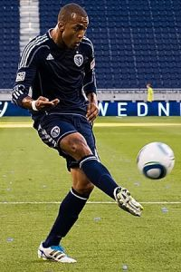 Sporting KC forward Teal Bunbury plays a ball ...