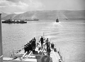 Escorts and merchant ships at Hvalfjord before...