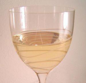 A glass of pinot grigio wine.