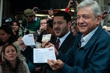 López Obrador (right) erroneously holding his Voter ID along with Martí Batres (center) after submitting the formal political registration of MORENA to the INE