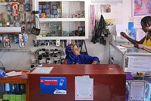 English: An M-Pesa agent in Tanzania. M-Pesa, ...
