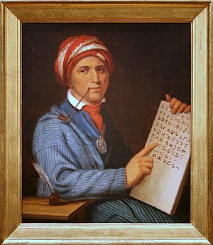 Oil on canvas painting of Sequoyah with a tabl...