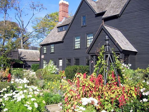 House of Seven Gables in Salem with a flowering garden in front.
