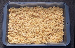 Rice Krispie treats in a pan lined with wax paper.
