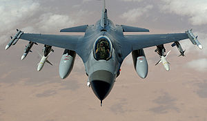A U.S. Air Force F-16 Fighting Falcon flies a ...