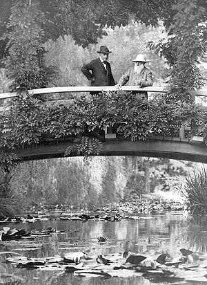 An image of Claude Monet in his garden in Give...