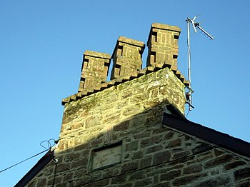 English: Unusual chimney These brick chimneypo...