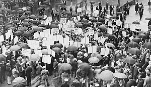 Crowd of depositors gather in the rain outside...