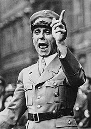 https://i2.wp.com/upload.wikimedia.org/wikipedia/commons/thumb/6/67/Bundesarchiv_Bild_102-17049,_Joseph_Goebbels_spricht.jpg/180px-Bundesarchiv_Bild_102-17049,_Joseph_Goebbels_spricht.jpg