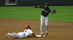 Lastings Milledge steals second base and the b...