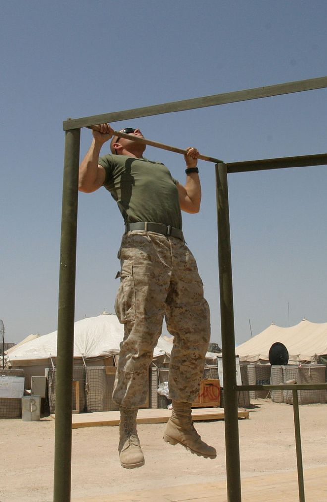 A US Marine Doing Pull-ups.
