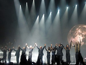 Roger Waters and his musicians in the tour Dar...