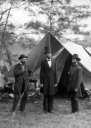 Lincoln, in a top hat, with Allan Pinkerton an...