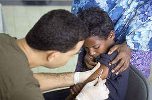 A Somali boy receives a polio vaccination at t...