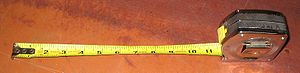 Self-retracting pocket tape measure (imperial)