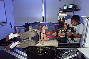 English: Science@NASA Using this human-sized c...