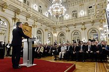 Macri speaking to an audience from a podium