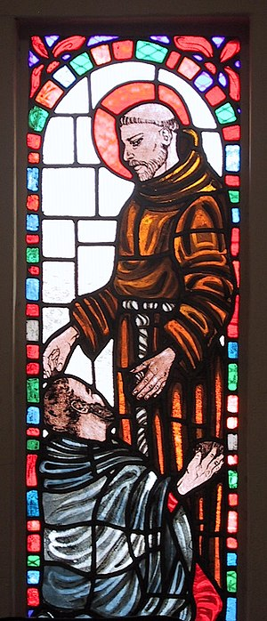 English: St. Francis and the Leper. A stained ...