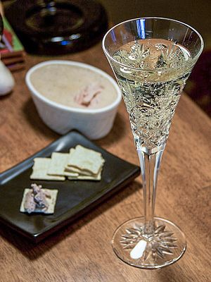 Champagne and pate on Thanksgiving. Date: 2004...
