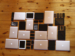 English: A variety of laptops, smartphones, ta...