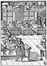 Un médico visitando a los enfermos en un hospital. Grabado alemán de 1682.