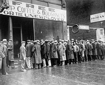 Unemployed men queued outside a depression sou...