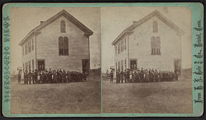 View of a two-story wood-frame school house wi...