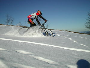 A cyclist with a mountain bike gets a workout ...