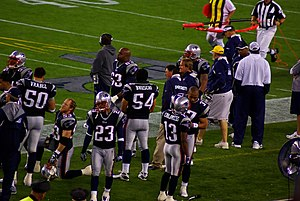 English: New England Patriots players on sidel...