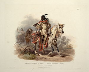 A Blackfoot indian on horseback